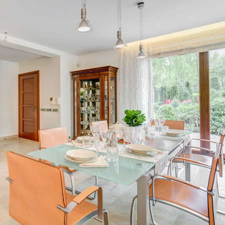 dining table and chairs: Glass table and modern chairs in the dining room
