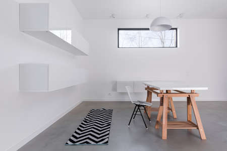Raw simple decor of spacious dining room