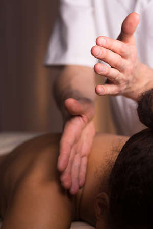 physiotherapists: Close-up of young woman having neck massage. Physiotherapists hand clapping the neck