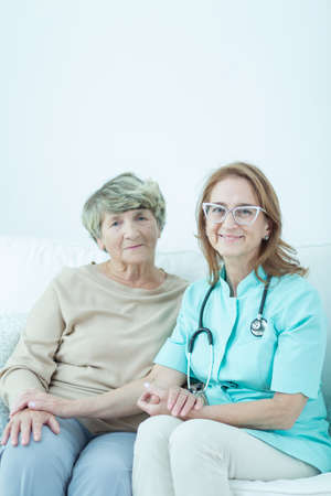 trusted: Trusted doctor is taking care of her elder patient Stock Photo