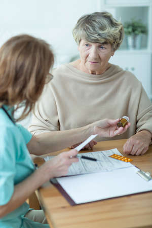 trusted: Trusted nurse is visiting elder lady at home
