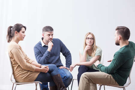 Young people talking in support group about problems