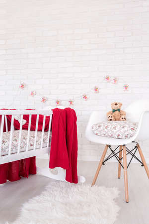 teddy bear baby: Shot of a red and white modern baby room