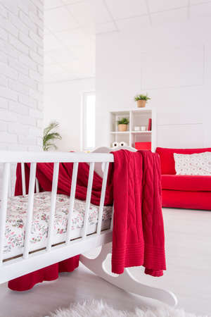 cosy: Shot of a cosy red and white studio apartment