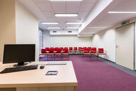 hall monitors: Shot of a modern empty spacious classroom