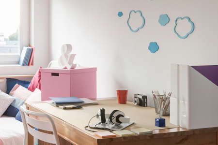 desk tidy: Tidy wooden desk in teenage girls study room Stock Photo