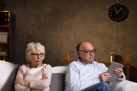 distance: Shot of an elderly couple having relationship issues Stock Photo