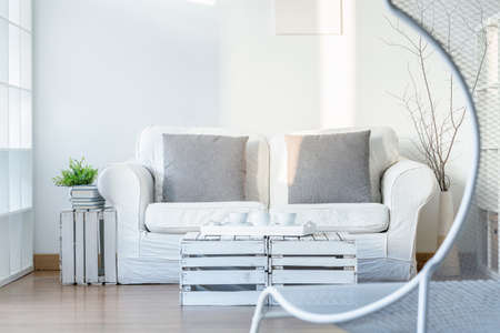 comfortable chair: Light interior with sofa, DIY small table and comfortable, white chair