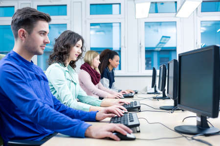 Shot of students using computers during an information technology class
