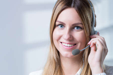 color consultant: Beautiful smiling woman in corporation talking with client Stock Photo
