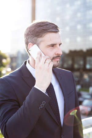 important phone call: Busy man making an important phone call