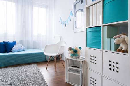 interior bedroom: Cozy modern room designed for little boy. Grey carpet on wooden floor