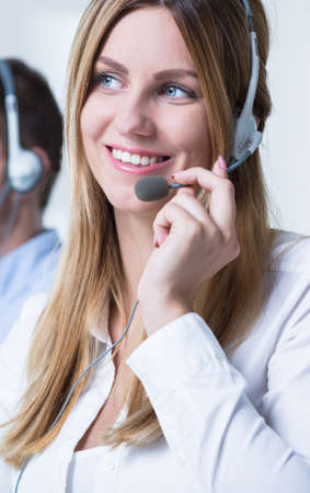 telemarketer: Young pretty woman at work as telemarketer