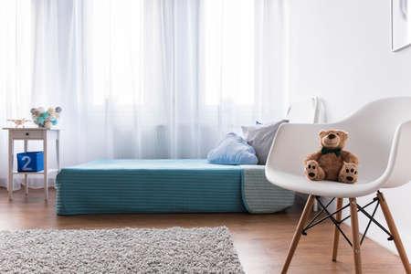bedroom bed: Blue single kids bed in modern new kids bedroom Stock Photo