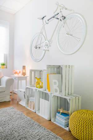 original bike: Vintage style bicycle as a decoration on wall in modern living room Stock Photo