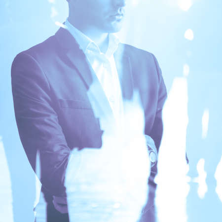 impression: Double exposure of businessman in suit and cityscape impression Stock Photo