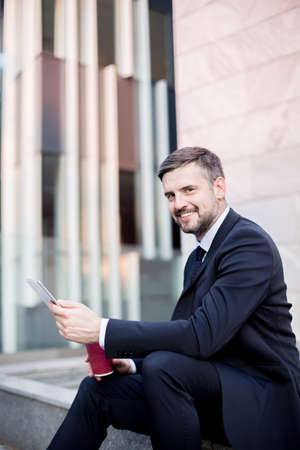 finance manager: Elegant handsome middle aged entrepreneur after work Stock Photo
