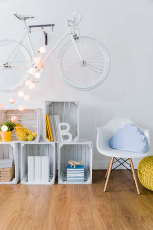 original bike: Bright space in students flat. Wooden floor and white wall with bicycle on it