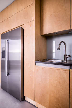 refrigerator kitchen: Modern kitchen design and double door refrigerator Stock Photo