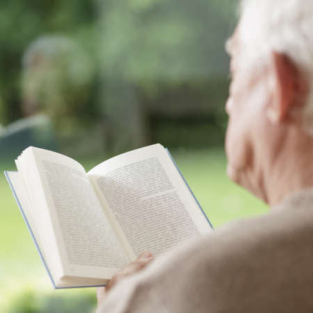 lonely person: Elder man reading book