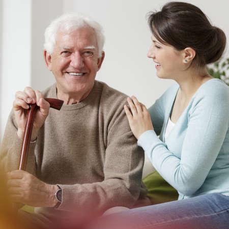 Elderly man with walking stick