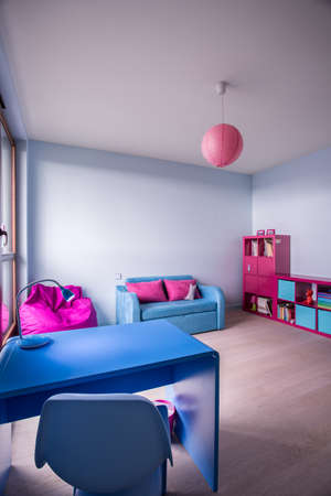 spacious: Spacious pink and blue kid room design Stock Photo