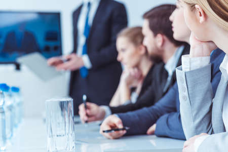 Firm management during business meeting in light office, blurry picture Stock Photo