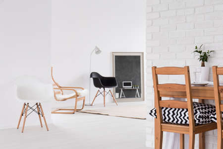 brick wall: Modern, white interior with new design chairs in black and white, decorative, brick wall texture