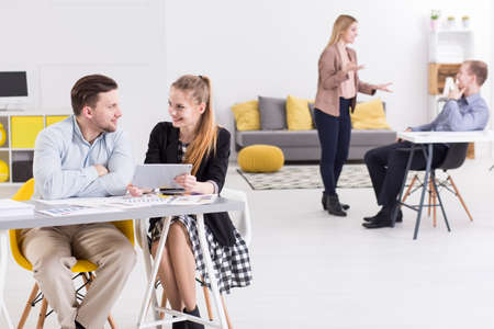 modern office: Positive businesspeople working together in light, spacious and modern office