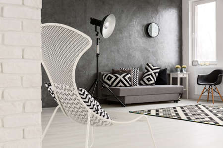 Grey Living Room Chairs. Grey living room with sofa  chairs standing lamp brick wall and decorations in Living Room With Sofa Chair Pattern Carpet And Pillows