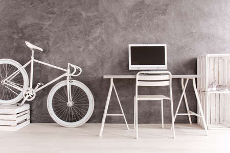home furniture: Grey interior with white bike, desk, chair, computer and DIY bookcase