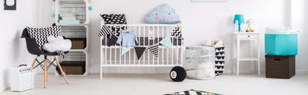 scandinavian people: Baby room in black, white and blue with simple cot and stylish decorations