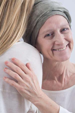fight disease: Senior woman with cancer smiling despite the tough disease