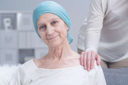 Sick older woman with cancer with inner strength to fight with disease Standard-Bild