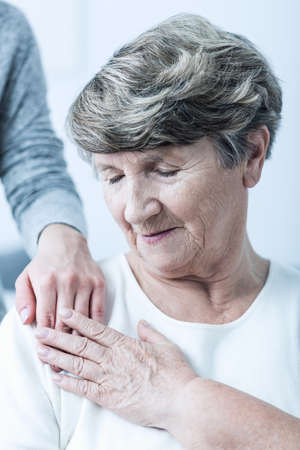 Image of senior woman with alzheimer having care