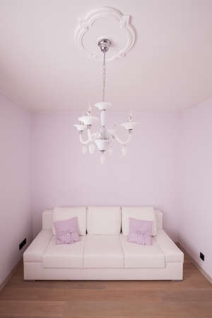 guest room: Leather white sofa in romantic guest room