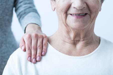 positive: Image of senior with positive attitude during therapy