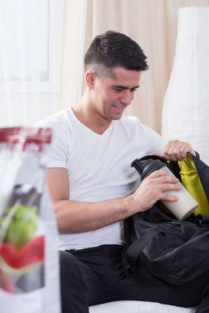 prepare: Happy muscular man preparing for workout on gym Stock Photo