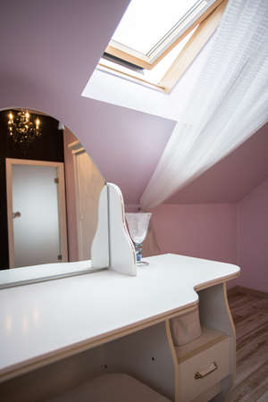 Image of lilac interior with white wooden dressing table