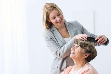 grandmother: Image of helpful woman take care of ill grandmother