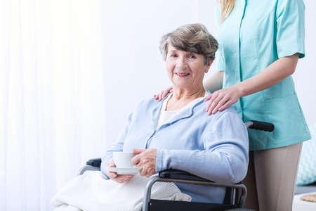 indigestion: Image of senior woman drinking tea for indigestion Stock Photo