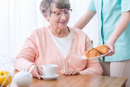 happy seniors: Photo of happy senior woman having home medical care