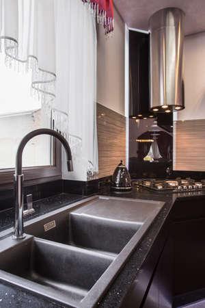 granite kitchen: Closeup of granite sink in elegant kitchen Stock Photo