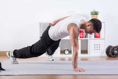 one hand: Strong man doing push-ups on one hand Stock Photo