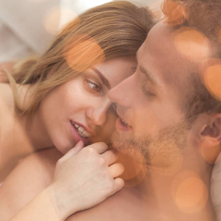 honeymoon: Young couple during romantic honeymoon in bed Stock Photo