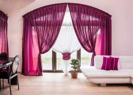 decorative balconies: Big window with elegant drapes and curtain