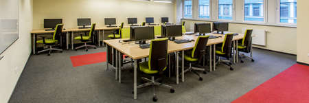 Spacious computer lab in modern medical university. Two rows of desks with new computers Stock Photo