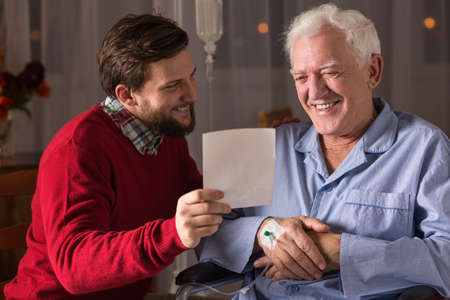 incurable: Photo of ill father and son spending time together Stock Photo