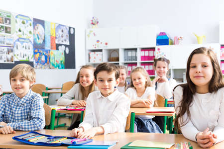schoolroom: Shot of a group of children sitting in a classroom