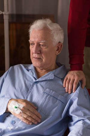 incurable: Image of depressed terminally ill senior having care Stock Photo